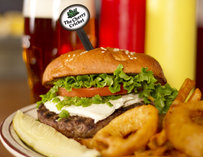 Burger topped with cream cheese & jalapeno