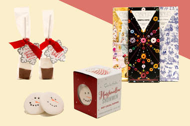 Chocolate bars, snowman beverage toppers, hot cocoa on a stick