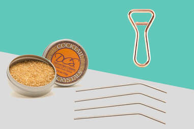 Metal straws, gold cocktail sugar, and copper bottle opener