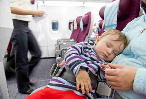 Kid sleep on a plane