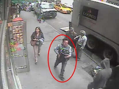 man running off with 86lb gold bucket