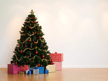 artificial Christmas tree decorated with presents