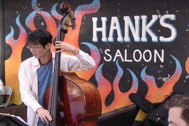 guy playing bass at Hank's Saloon