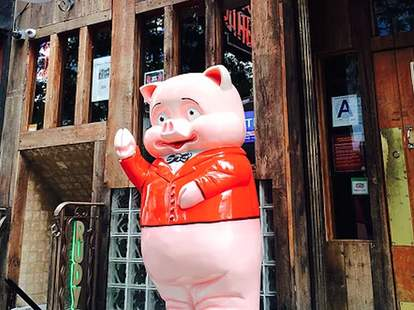pig statue standing outside Rudy's Bar