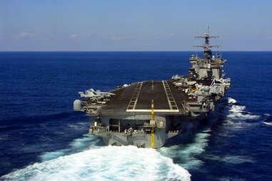 Plane landing on aircraft carrier