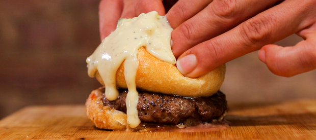 This NYC Restaurant Is Serving a 'Burger Bomb' With a Cheese-Filled Bun