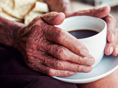 old hands and coffee