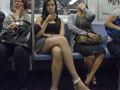 woman on phone on subway