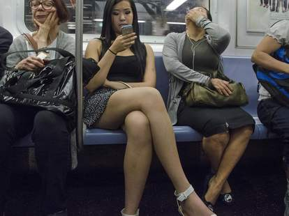woman on phone on subway
