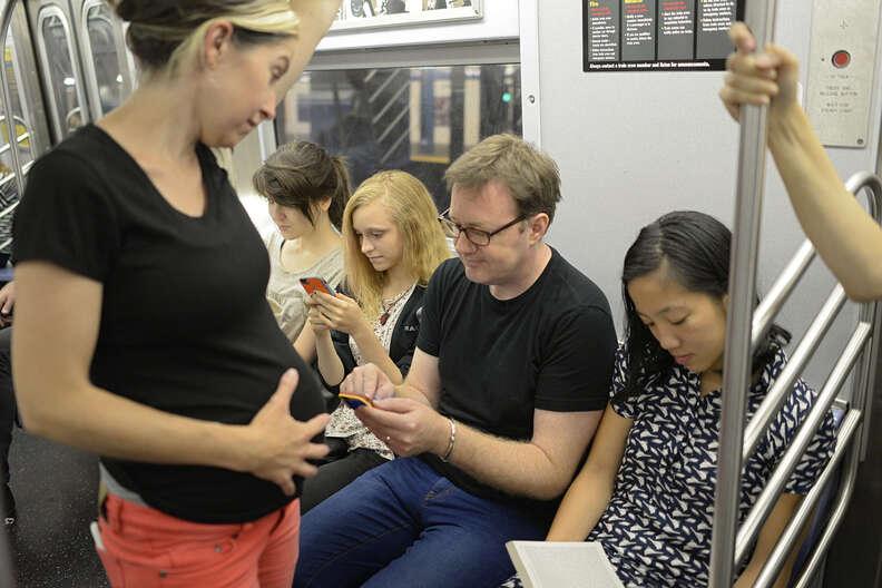 pregnant woman on subway