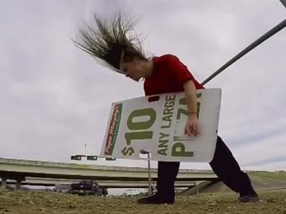 headbanging sign spinner