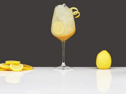 Champagne cobbler cocktail with lemon twist