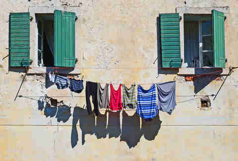 colorful clothes hanging on a patio