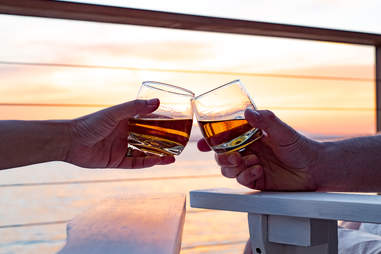 couples cheersing glasses of whiskey