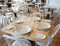 Tables with place settings inside Seed Kitchen & Bar