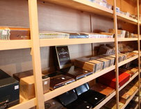 Shelves of cigar boxes