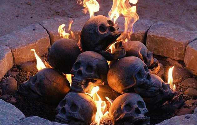 These Human Skull Logs Will Make Your Home Firepit Immeasurably Disturbing