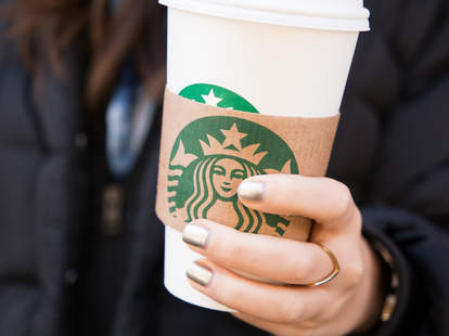 starbucks cup in hand
