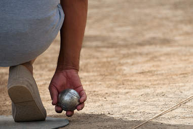 Guy playing bocce ball