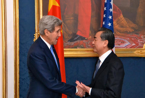 john kerry greeting chinese foreign minister