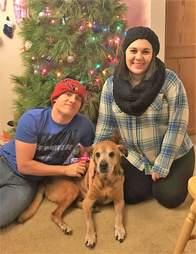 Senior shelter dog spending Christmas at his new home