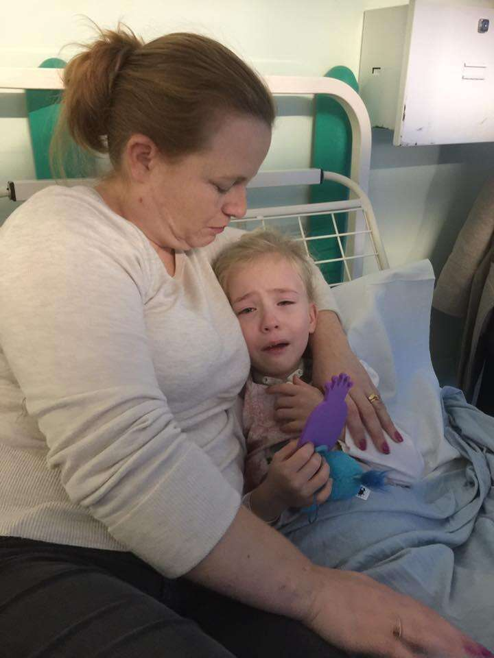 Girl with special needs crying in hospital