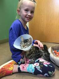 8-year-old Britta with her blind rescue cat, Lucky