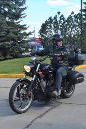 Service dog on back of motorcycle