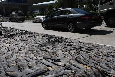 Shark fins drying out on the street in Hong Kong