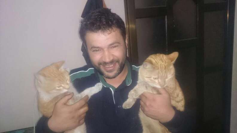 Alaa with two rescue cats