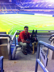 Bodza, a former bomb detector dog for the U.S. air force, and his owner, Kyle Smith.