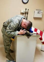 Solider Kyle Smith crying over the body of his beloved dog, Bodza, who once worked as a bomb detector for the u.s. air force.