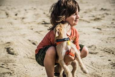 Diego Camblor of Compassion Without Borders with a dog rescued from Mexico