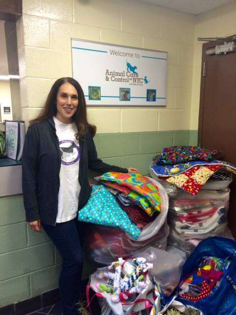jennifer halpern with shelter donations through pillows for paws