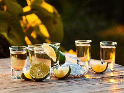 limes next to tequila shots