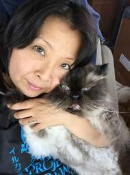 Woman with the cat she loves
