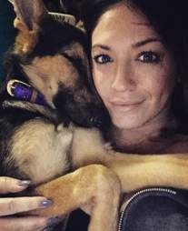 Woman cuddling German shepherd