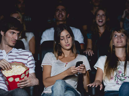 woman texting during movie