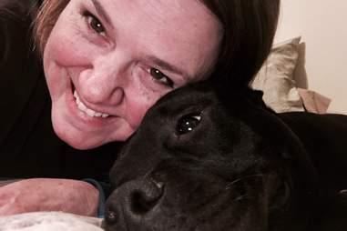 nurse takes care of man's dog