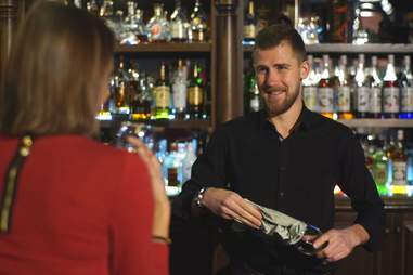 woman talking to bartender