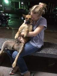 Woman with rescued street dog
