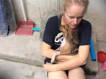 Woman with rescued puppy