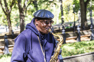 Man playing sax in central park