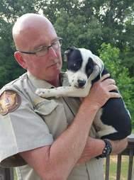 Cop cuddling rescue dog