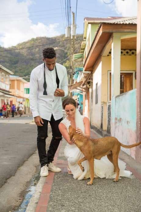 Logan Ryan and Ashley Bragg with dog