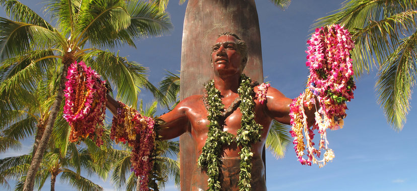 The Statue of Duke Kahanamoku, draped with leis