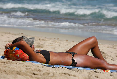 tanned woman at the beach