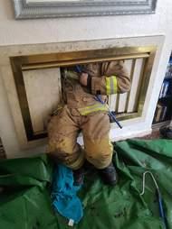 kitten rescued from chimney