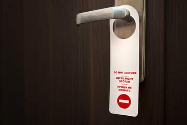 Hanging Do Not Disturb Sign On Door