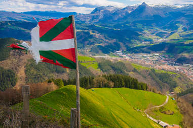 Basque Country Flag flying with Txindoki Mountain in the background